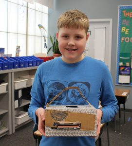 A Wolf student shows off his latest invention on Kid Inventor Day!