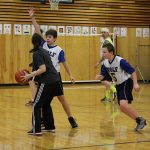 A Wolf Student works on blocking his parent as students play defense