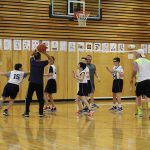 Wolf students play a strong defense as a parent takes a shot