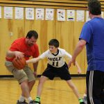 A Wolf student steals the ball from a parent
