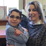 A Room 3 student enjoys spending time with his special visitor
