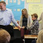 Grandparents' and special guests take part in a science experiment in Room 4