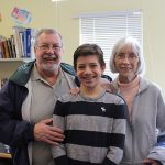 A Room 8 student with his grandparents
