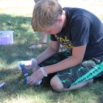 Students enjoy the beautiful weather as they dye their t-shirts