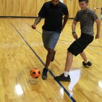 Students learn the basics of soccer