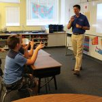 A pilot talks with campers about his professional experience