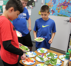 Wolf Students try new food they helped to grow in their classroom garden