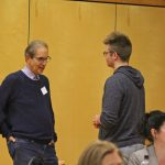 Dr. John Ratey talks with a conference goer