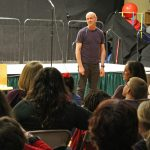 The Wolf School's Music Teacher, Andy, introduces the next performance