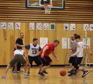 A parent goes after the ball after a rebound