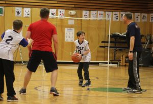 A Wolf student works on bringing the ball to the hoop!