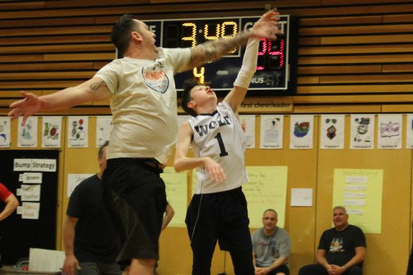 A parent attempts to block a shot