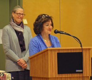 Rosy Granoff, Interim Director of Enrollment, presents a special award to Jeanette Epstein and Jon Green