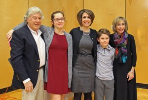 Anna Johnson poses with her family after being awarded the 2019 Founders' Day award