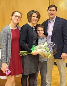 Anna Johnson with her family after being surprised with the 2019 Founders' Day award!